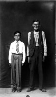 http://bernalespacio.com/files/gimgs/th-47_MikeDisfarmer From the Heber Springs Portraits (man and boy with arms at sides) 1940s.jpg